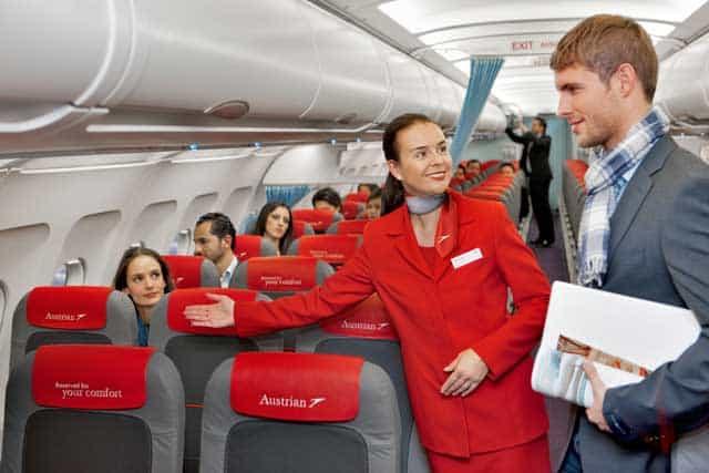 Austrian Airlines flight attendant and passenger