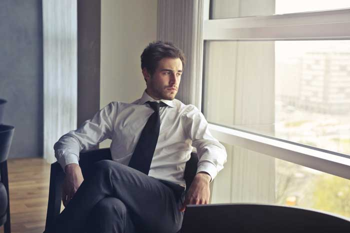 man wearing white dress shirt and black necktie 716411