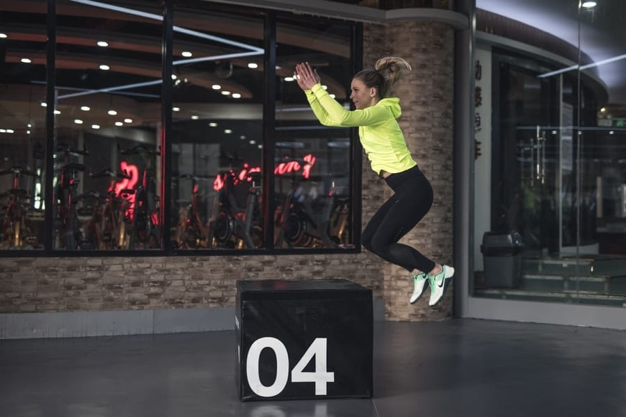 photo of woman jumping on box 2294403